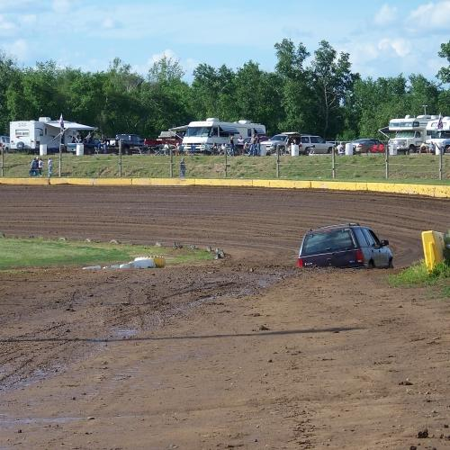 A view of the Cedar Lake Speedway back stretch from the pit area.  Notice that RV's park along turns 3 and 4 for a great view of the races.