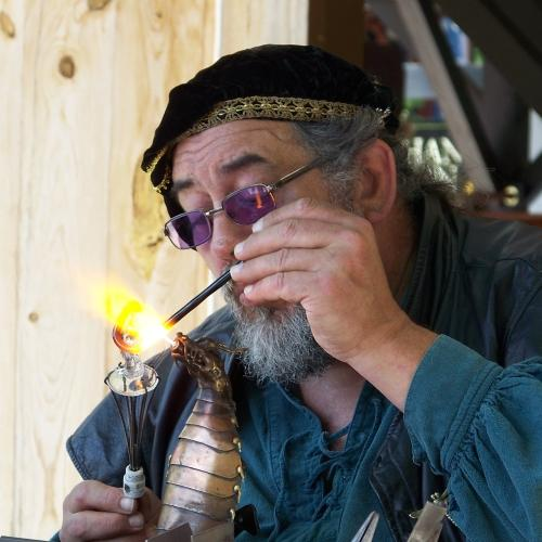 A glassblower at work at the Bristol Renaissance Faire