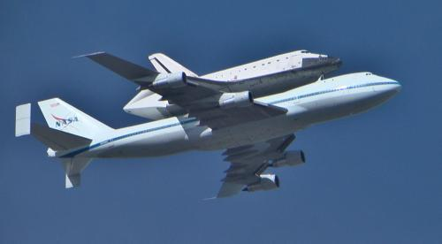 Shuttle Endevour and the 747 transport passing over Alameda, CA on its way to its final home in LA.