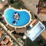 Big swimming pool with its own island (Google Maps)