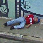 Hand down his pants & passed out on sidewalk