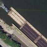 Tugboat and barge passing through lock (Google Maps)