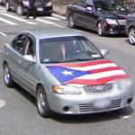 Car with Puerto Rican flag on the hood