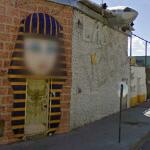 Cleopatra and an airplane decorating a bar (StreetView)