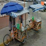 Two white stripe trike carts