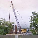 Crane setting piles