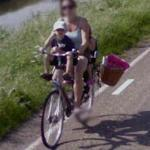 Mother and child on bike (StreetView)