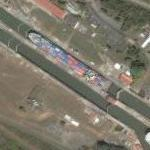 Panama Canal with cargo ship (Google Maps)