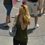 Woman on cell phone (StreetView)
