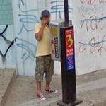 Guy on a payphone