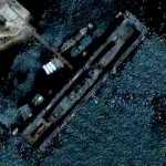 Military Ship in a floating dry dock (Google Maps)