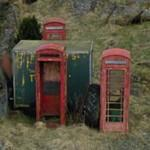 4 red British miniature phone boxes