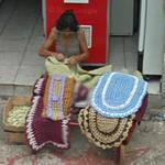Woman making a rug