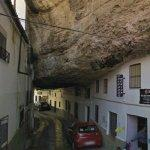 Cliff overhanging a narrow street