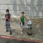 Children playing in the spray of a fire hydrant