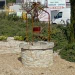 Hand-dug well in roundabout