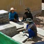 Female workers cleaning concrete slabs