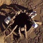 Men at a well in the desert (Google Maps)