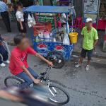 Cycling past a temporary retail cart