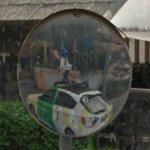 Google car reflection in a mirror