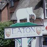 Elephant carrying a barrel on a village sign