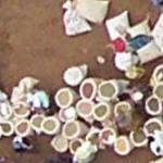 People with open sacks of grain in the market (Google Maps)