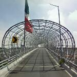 Covered roadway and large Mexican flag