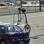 Penny-farthing mounted on a car