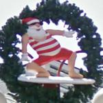 Santa on a surf board (StreetView)