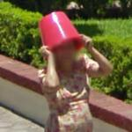 Woman with a bucket on her head
