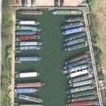 Many docked canal barges