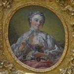 """A young lady holding a pug dog"" by François Boucher"