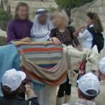 Tourists posing with a donkey and an Arab (StreetView)
