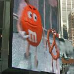 M&M and pretzel on a JumboTron
