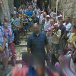 Google moves through a throng of tourists