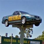 Holden Ute on a sign pole