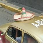 Sombrero on roof of a VW Beetle (StreetView)
