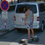 Man on a motorized skateboard