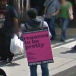 Man wearing a sandwich board ad (StreetView)