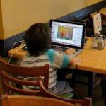 Kid on a laptop (StreetView)