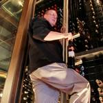 Chef Joseph Heidenreich in the giant wine cooler