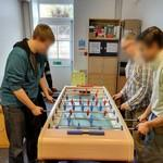 Playing table football/soccer