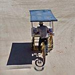 Drink seller cycling on empty beach (StreetView)