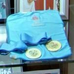 Two 1996 Summer Olympics medals and a shirt