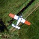 Airplane - Red-winged Plane in flight (Google Maps)