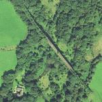 Railroad bridge with trees (Google Maps)