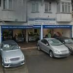 4 Nissan Figaro cars at a car dealer (StreetView)