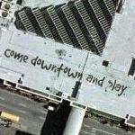 """come downtown and play."" on the Roof of Peabody Place Entertainment and Retail Center (Google Maps)"