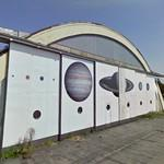 The Planets of our Solar System painted on former hangar