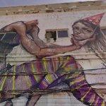 Graffiti of Girl holding her head